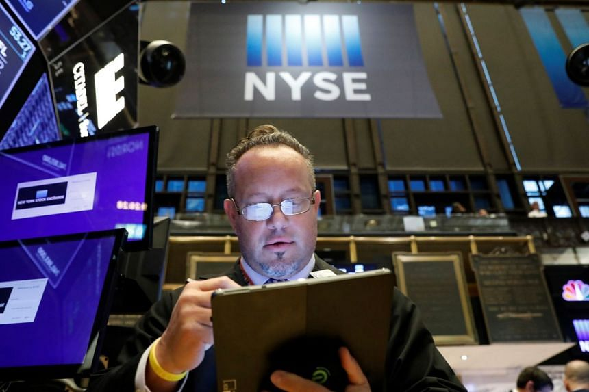 A trader works on the floor at the New York Stock Exchange, Oct 22, 2019.