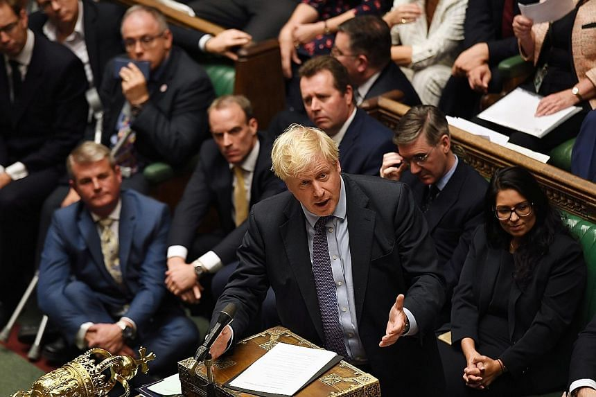 Britain's Prime Minister Boris Johnson in the House of Commons on Tuesday. Mr Johnson had failed to reach an agreement with opposition Labour leader Jeremy Corbyn on a new timetable to push his new Brexit deal through Parliament. The two met in Westm