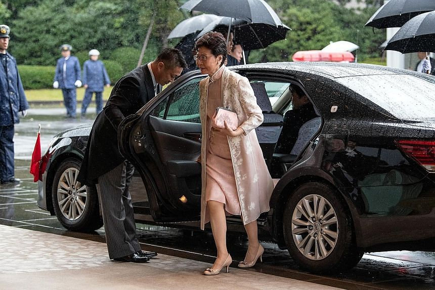 Hong Kong Chief Executive Carrie Lam arriving in Tokyo on Tuesday to attend the enthronement ceremony of Japan's Emperor Naruhito. China has said that it supports Mrs Lam's efforts in putting an end to the violence and chaos in Hong Kong and restorin