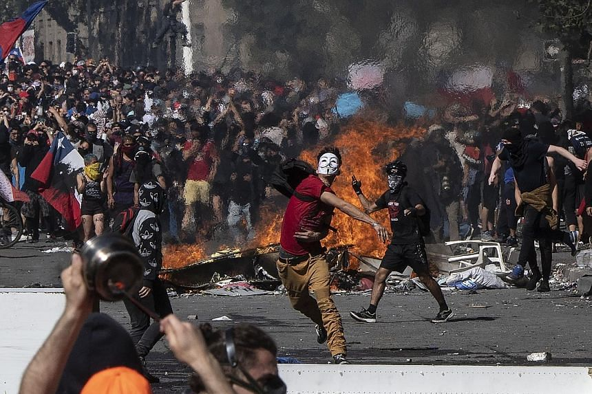 Protesters in the Chilean capital Santiago turning violent on Tuesday, the fifth straight day of street unrest which erupted over a now suspended hike in subway ticket prices. The protests have spread to cities and towns, as people rally against low