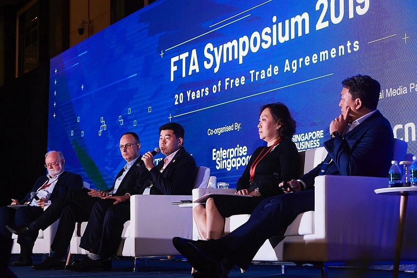 (From left) Moderator Evan Rogerson, an adjunct senior fellow at the S. Rajaratnam School of International Studies; Mr Frank Debets, managing partner of PwC Worldtrade Management Services; Mr Gabriel Lim, Permanent Secretary of the Ministry of Trade