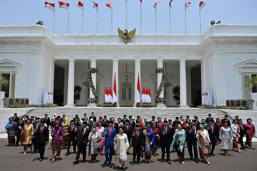Indonesian President Joko Widodo and his wife Iriana Widodo (in front, centre) with his ministers and their spouses at Merdeka Palace in Jakarta yesterday.