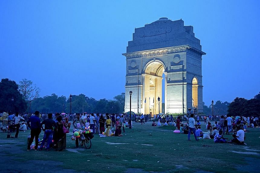 The 42m-high India Gate, a war memorial, is one of many historical buildings that line a 3km stretch in New Delhi, with architecture combining Mughal, British and Indian influences. They were all built in the early 1900s. ST FILE PHOTO