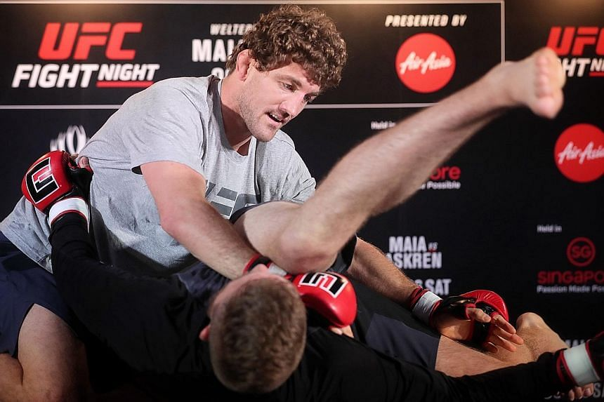 Ultimate Fighting Championship (UFC) fighter Ben Askren thrilled local fans with his grappling skills at the Clarke Quay Fountain Square, during the Fight Night Singapore open workouts last night. The 35-year-old American former Olympic wrestler will