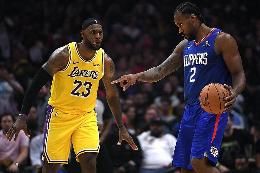 LA Clippers' Kawhi Leonard (right) controlling the ball as LeBron James of the LA Lakers approaches during their NBA game in Los Angeles on Tuesday. The Clippers, with Lou Williams saying they wanted to debunk the notion that they are the 'little bro