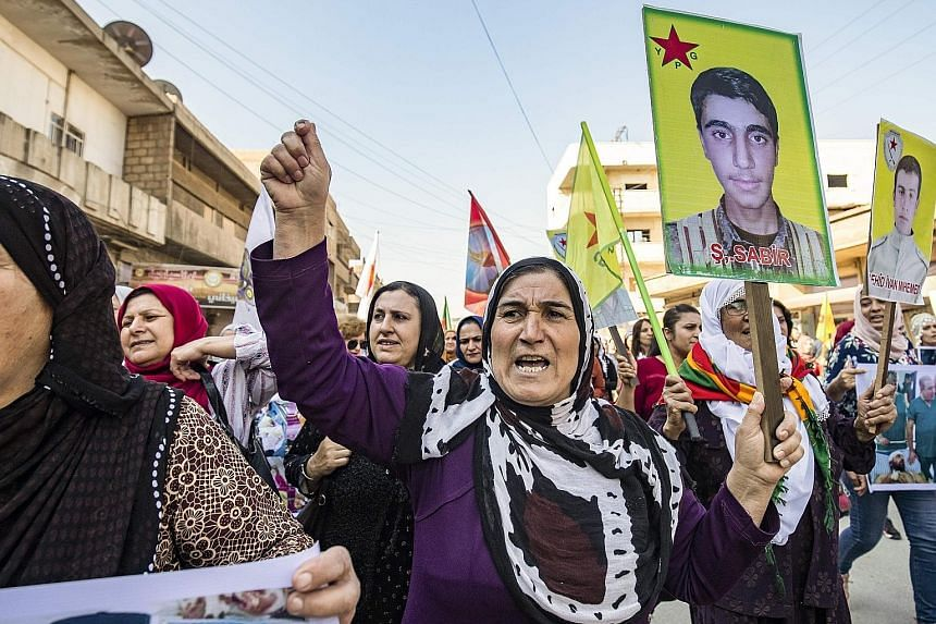 Syrian Kurds protesting against the Turkish assault on north-eastern Syria, yesterday. Kurdish forces, which held close to a third of Syria two weeks ago, have now lost almost everything, after a deal struck between Moscow and Ankara on Tuesday.