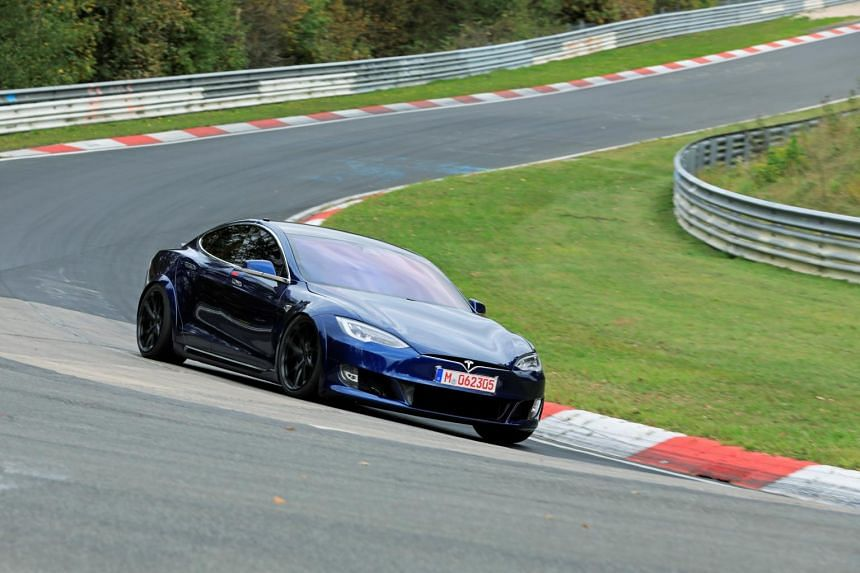 In this photo taken on Oct 15, 2019, a Tesla Model S is steered at a race track in Eifel, Germany. The model's retractable door handles are blamed for the accident.