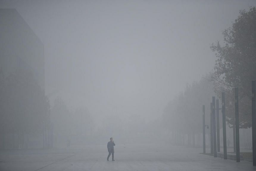 In this picture taken on Nov 26, 2018, a man walks amid smog in Tianjin, China.