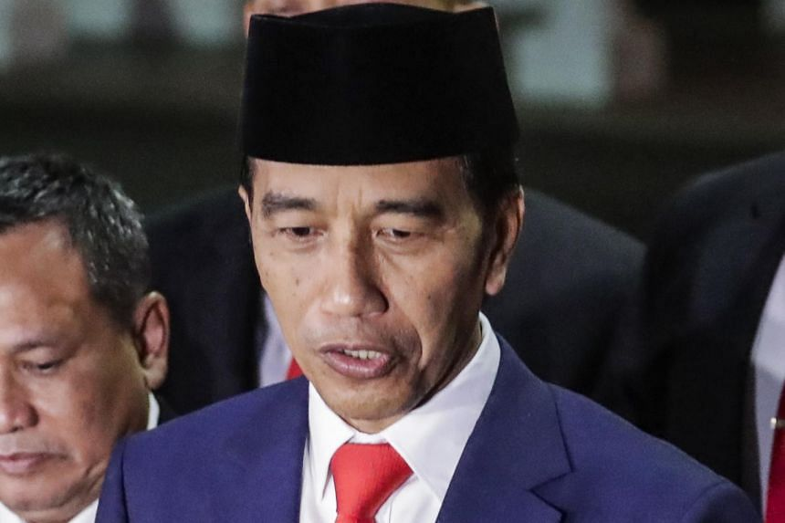 Indonesian President Joko Widodo gave his new Cabinet a month to identify and revise government regulations that overlap and are overly complicated, and stressed that the biggest goal is to create jobs.
