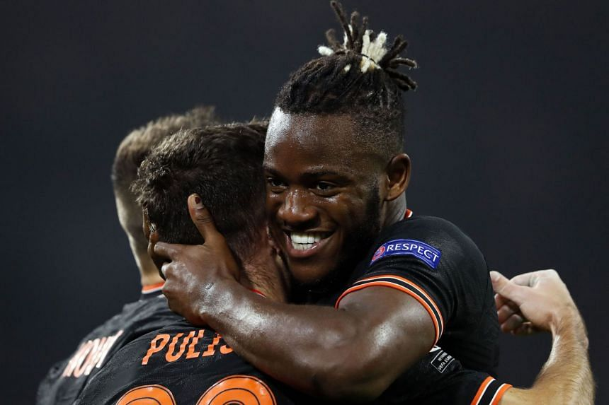 Batshuayi (right) celebrates with team mates after scoring.