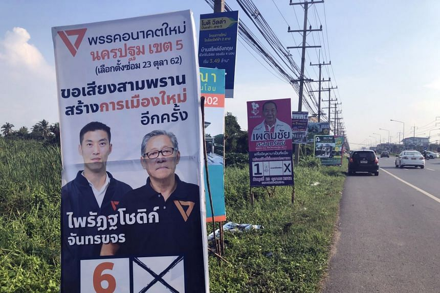 Campaign posters for the Future Forward Party (left) and Chart Thai Pattana Party in Nakhon Pathom province, Thailand.