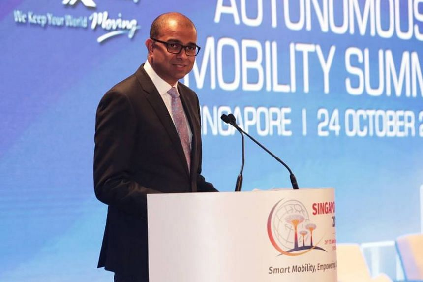 Senior Minister of State for Transport Janil Puthucheary delivering a speech on autonomous vehicles at the Intelligent Transport Systems World Congress.