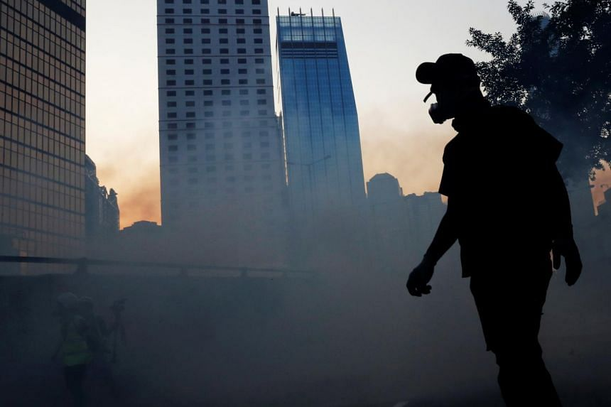 An anti-government protester silhouetted with a building during a demonstration near the Central Government Complex in Hong Kong, on Sept 15, 2019.