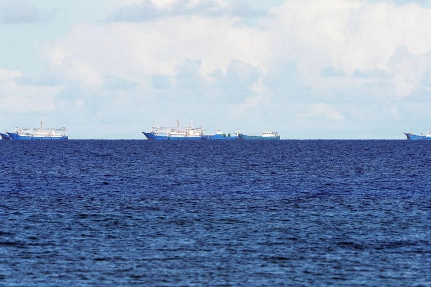 Chinese boats anchor near the reef Subi, on July 31, 2019. Tension between Hanoi and Beijing escalated when China sent the vessel to conduct seismic surveys in waters off Vietnam in early July.