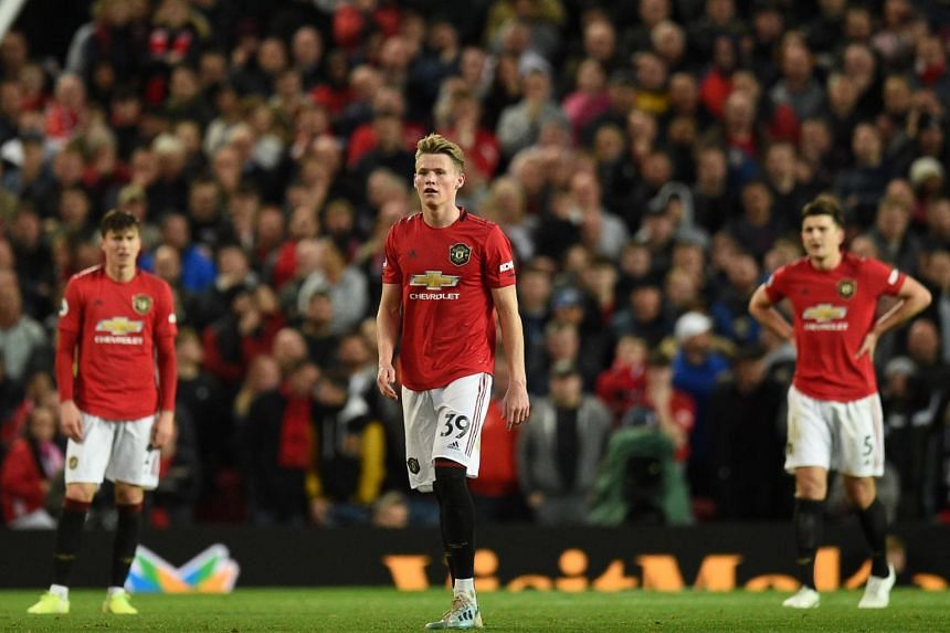 Manchester United's Victor Lindelof (left), Scott McTominay (centre) and Harry Maguire react to conceding Liverpool's first goal in England on Oct 20, 2019.