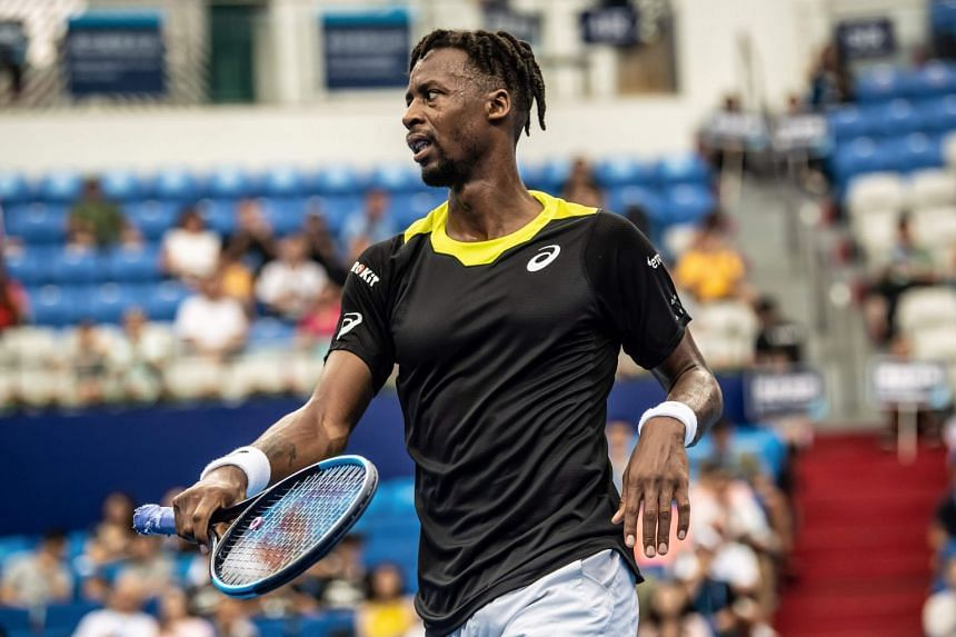 Monfils reacts after a point against Albert Ramos-Vinolas of Spain.