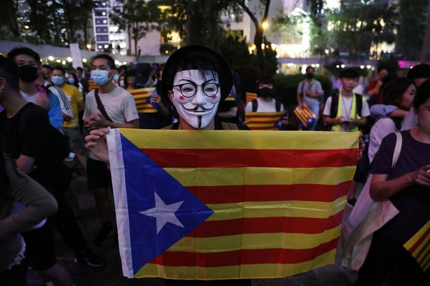 Protesters gather in Hong Kong's Chater Garden to show their solidarity with the Catalonian independence movement on Oct 24, 2019.