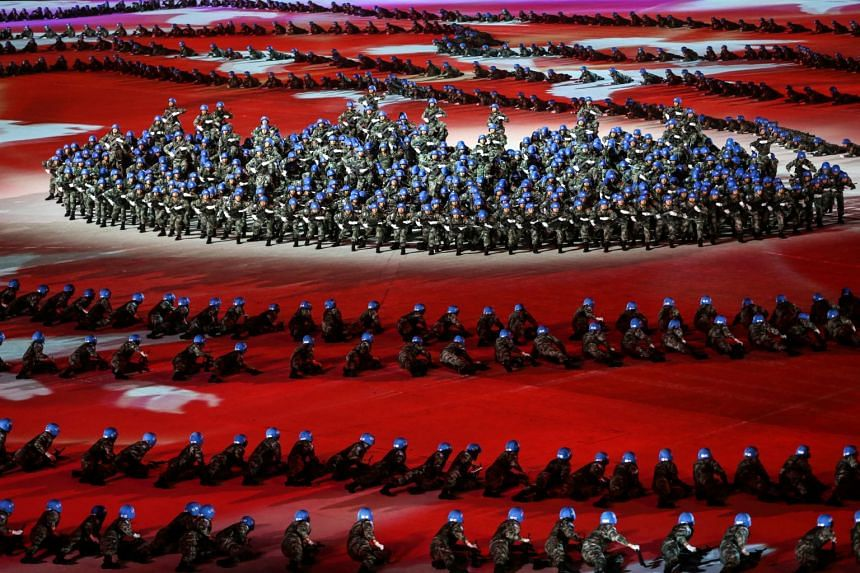 A photo taken on Oct 18 shows the opening ceremony of the Military World Games in Wuhan, China. A Chinese orienteering team was disqualified after using secret paths and markings at a middle-distance competition during the Games.