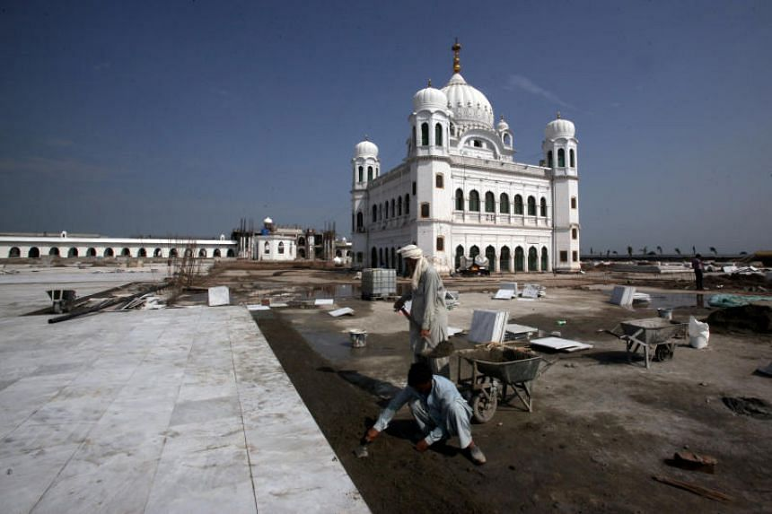 A photo taken on Sept 16 shows labourers working at the site of the Gurdwara Darbar Sahib in Kartarpur, Pakistan, which will be open this year for Indian Sikh pilgrims.