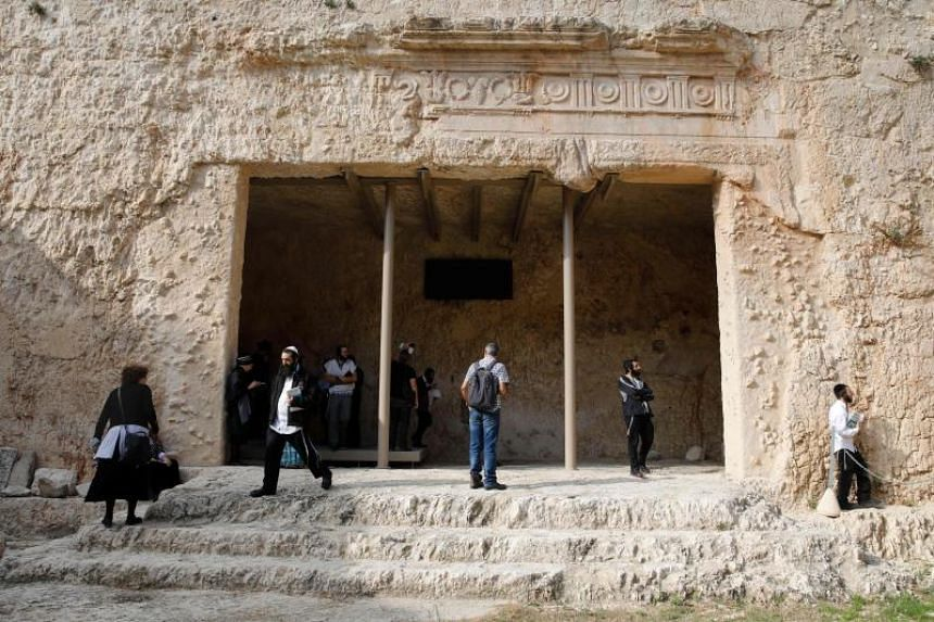 Ultra-Orthodox Jews walk at the Tombs of the Kings, a 2,000-year-old archaeological gem in the heart of Jerusalem owned by France, as it reopens for the public for a second time in six months, on Oct 24, 2019.