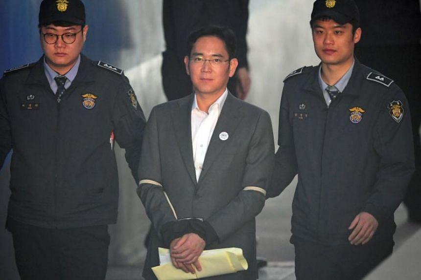 In a file photo taken on on April 13, 2017, Samsung vice-chairman Lee Jae-yong is escorted by prison guards as he arrives at the Seoul Central District Court for his trial in Seoul.