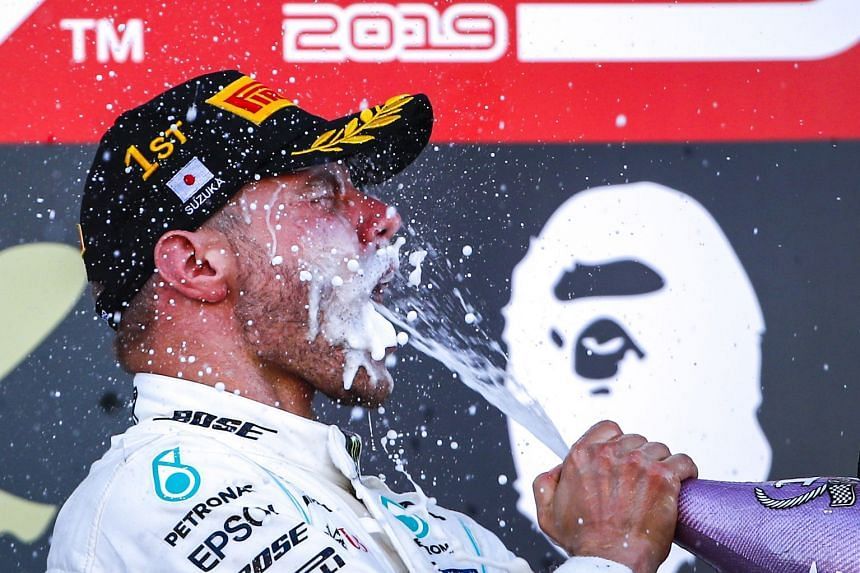 Bottas celebrates with champagne after winning the Japanese Grand Prix.