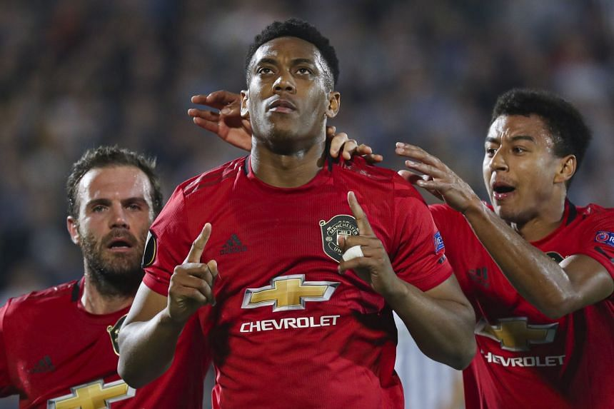 Manchester United's Anthony Martial (centre) celebrates after scoring.