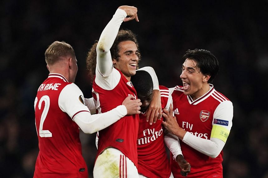 Pepe (second right) celebrates with team mates after scoring the winning goal.