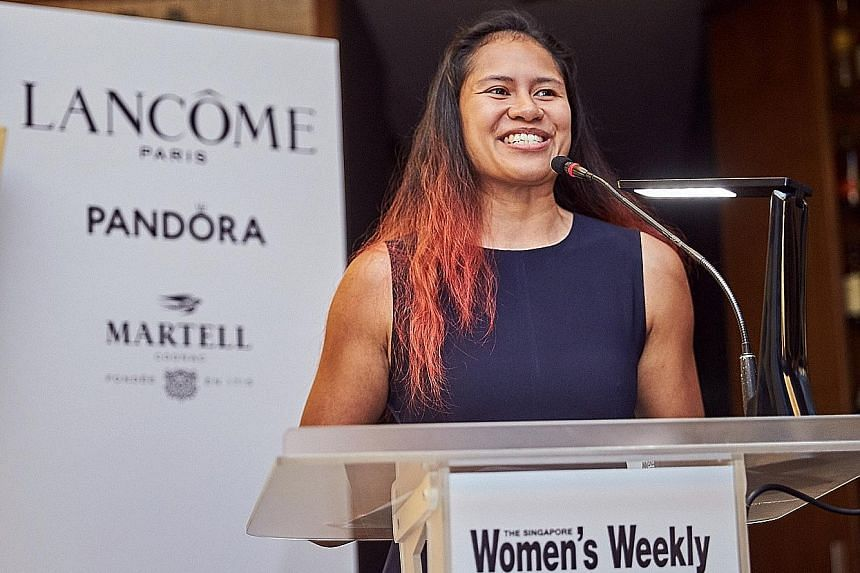 Singapore's first female professional boxer Nurshahidah Roslie was honoured yesterday with a Great Women of Our Time Award, given by The Singapore Women's Weekly magazine. Another winner was Dr Andie Ang, a research scientist at the Wildlife Reserves