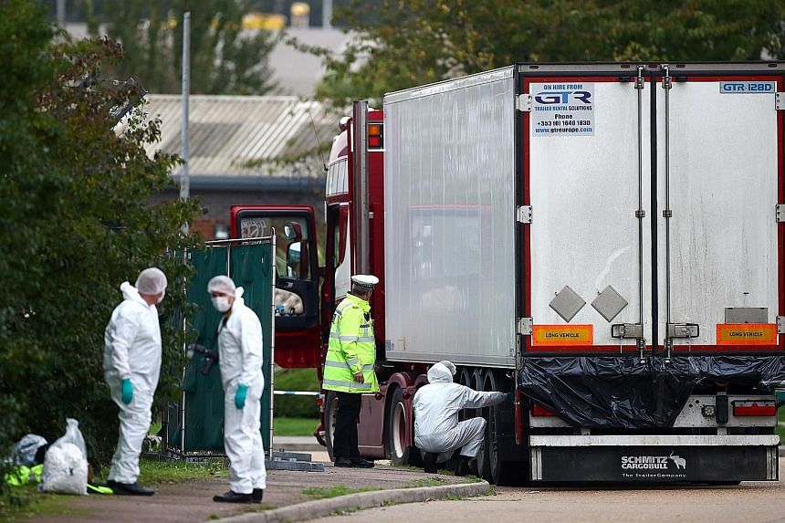 Police at the scene where the 39 bodies were discovered in the back of a truck in Essex, Britain, on Wednesday. Essex police said their priority was ensuring dignity for the victims during their inquiry.