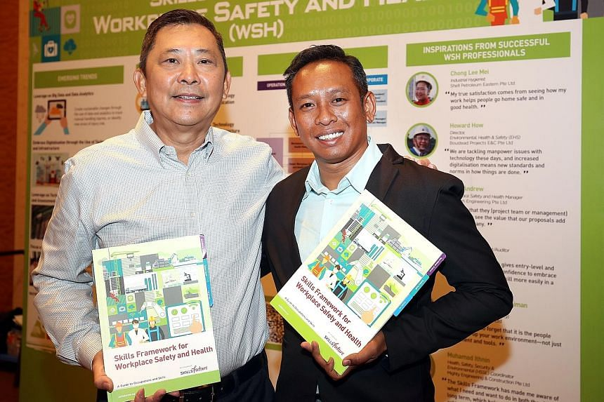 Workplace safety and health director Howard How (left) and health, safety, security and environmental coordinator Muhamad Ithnin are among those who welcomed the new Skills Framework for Workplace Safety and Health, which was announced yesterday.