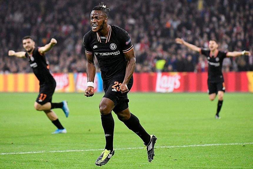 Chelsea forward Michy Batshuayi celebrating after scoring the 86th-minute winner in Chelsea's 1-0 defeat of Ajax in the Champions League in Amsterdam on Wednesday. It was Chelsea's second straight Group H win. PHOTO: REUTERS