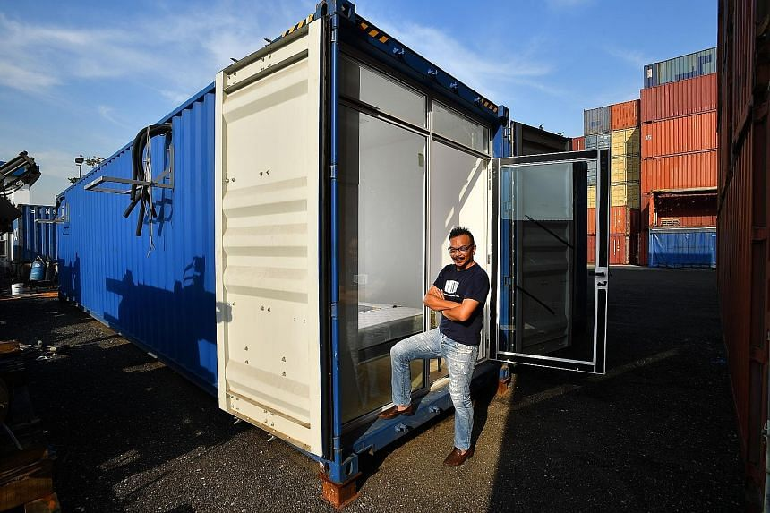 Entrepreneur Seah Liang Chiang (right) dreams of having 50 container hotels spread across 20 locations islandwide. The containers are equipped with a toilet, kitchen and dining area (above), TV, sofa, and a bedroom with a queen-size bed (below). ST P