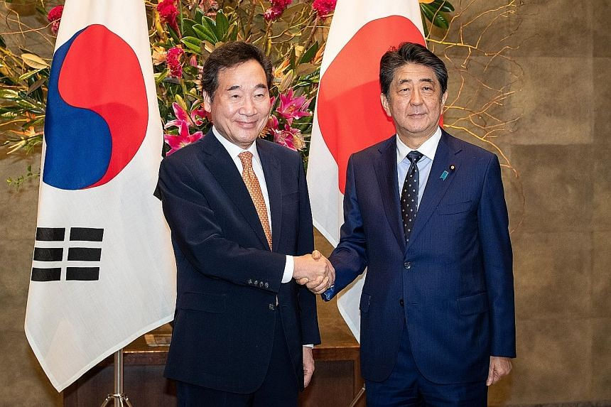 South Korean Prime Minister Lee Nak-yon (left) with Japanese Prime Minister Shinzo Abe during their meeting in Tokyo yesterday. Relations between Tokyo and Seoul have deteriorated to their lowest level in decades. PHOTO: EPA-EFE