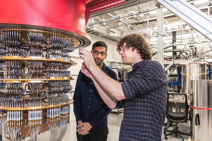 Google's chief executive Sundar Pichai and a researcher from the company with the quantum computer machine. Scientists have likened Google's announcement to the Wright brothers' first plane flight in 1903 - proof that something is really possible eve