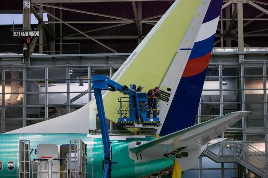 Boeing employees work on the tail of a Boeing 737 NG at the Boeing plant in Renton, Washington, on Dec 7, 2015. South Korea said it found nine planes with cracks among 42 planes examined.