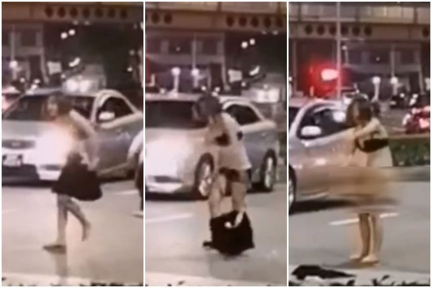 In a video circulating online, a woman is seen chasing after a man wearing a red T-shirt, before tearing off her dress and her panties while shouting and pointing at the retreating man.