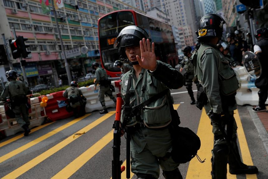 Hong Kong police fire tear gas to disperse harbour-front protesters