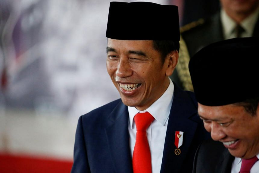 In a photo taken on Oct 20, 2019, Indonesian President Joko Widodo reacts to journalists, following his inauguration and a swearing-in ceremony, at the House of Representatives building in Jakarta.