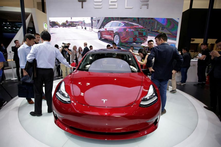 A Tesla Model 3 car is displayed during a media preview in Beijing, China Apr 25, 2018.