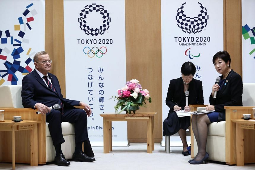 Chairman of the Tokyo 2020 Olympic Games coordination committee John Coates (left) meeting Tokyo Governor Yuriko Koike in Tokyo on Oct 25, 2019.