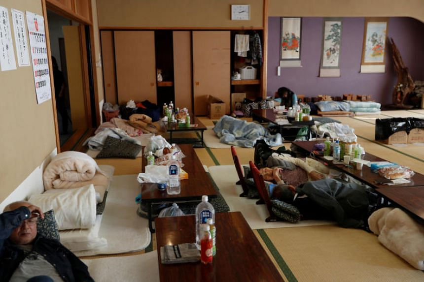 People rest at an evacuation centre in the aftermath of Typhoon Hagibis in Yanagawamachi district, Date City, Fukushima prefecture, Japan on Oct 16, 2019.