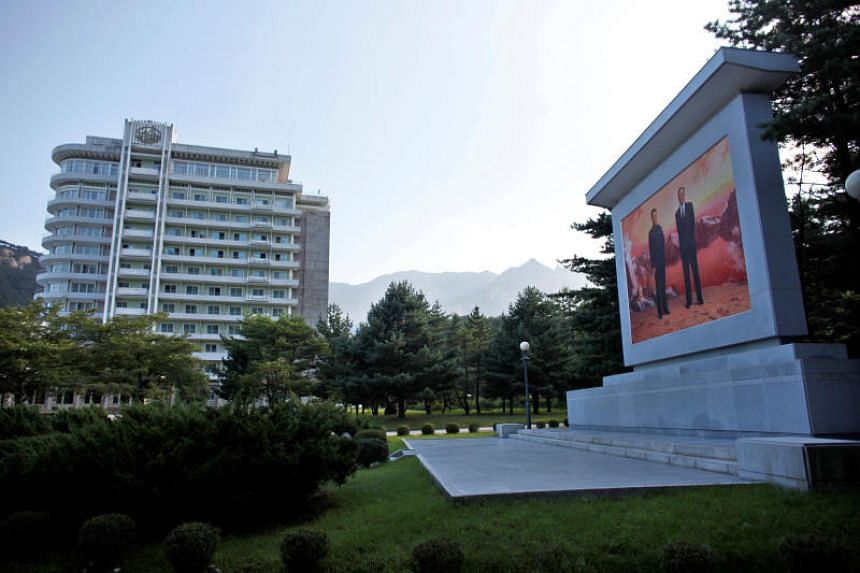In a file photo taken on Sept 1, 2011, a portrait of North Korean leaders Kim Jong Il (left) and Kim Il Sung is seen at Mount Kumgang resort in Kumgang, North Korea.