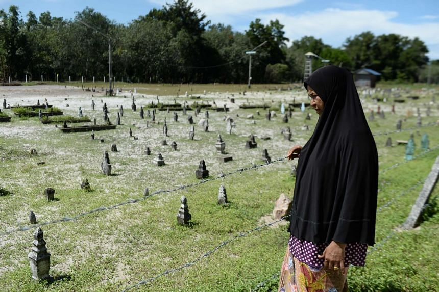 Widow Sitirokayah Salaeh visits the cemetery in Tak Bai where her late husband Mahamad Lohbako is buried together with other anti-government demonstrators who died during the 2004 Tak Bai incident, in Narathiwat, Thailand, on Oct 24, 2019.