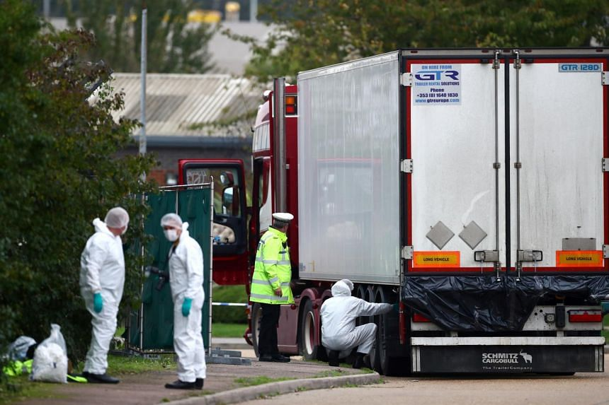 Police are seen at the scene where bodies were discovered in a lorry container, in Grays, Essex, Britain, on Oct 23, 2019. The truck had arrived on a ferry from Belgium.