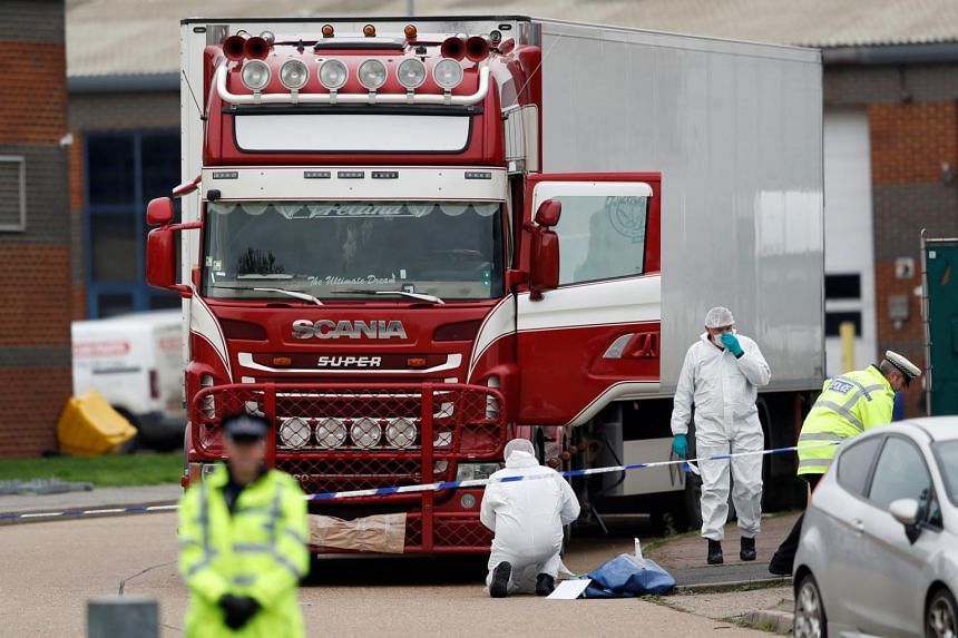 British police forensic officers work by a lorry where the bodies of 31 men and eight women were found on an industrial estate at Grays in Essex on Oct 23, 2019.