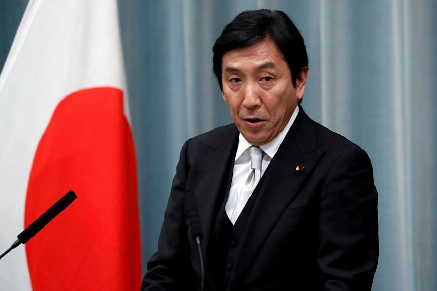 Japanese Economy Minister Isshu Sugawara told reporters he tendered his resignation, becoming the first member of Mr Abe's new Cabinet to leave.