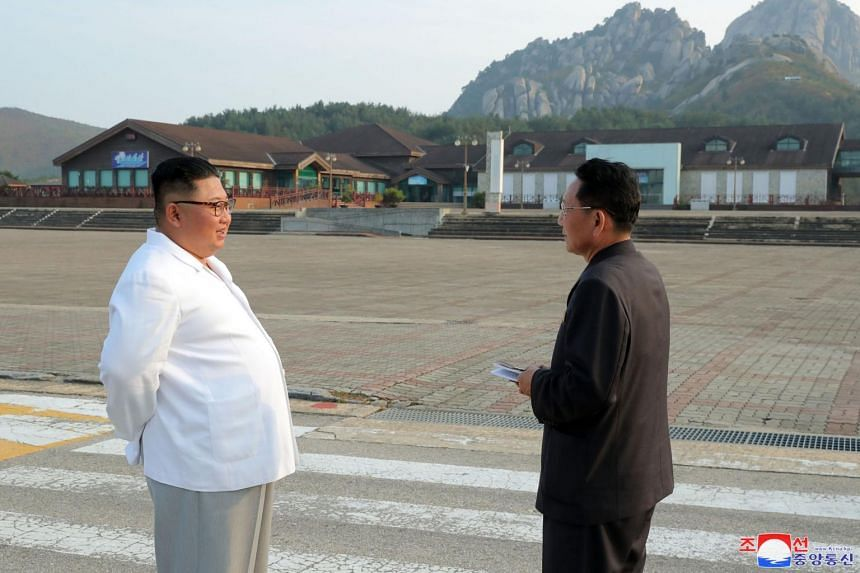 A photo provided by the state North Korean news agency (KCNA) on Oct 23, 2019 shows North Korean leader Kim Jong Un (left) visiting the tourist region Kumgangsan.