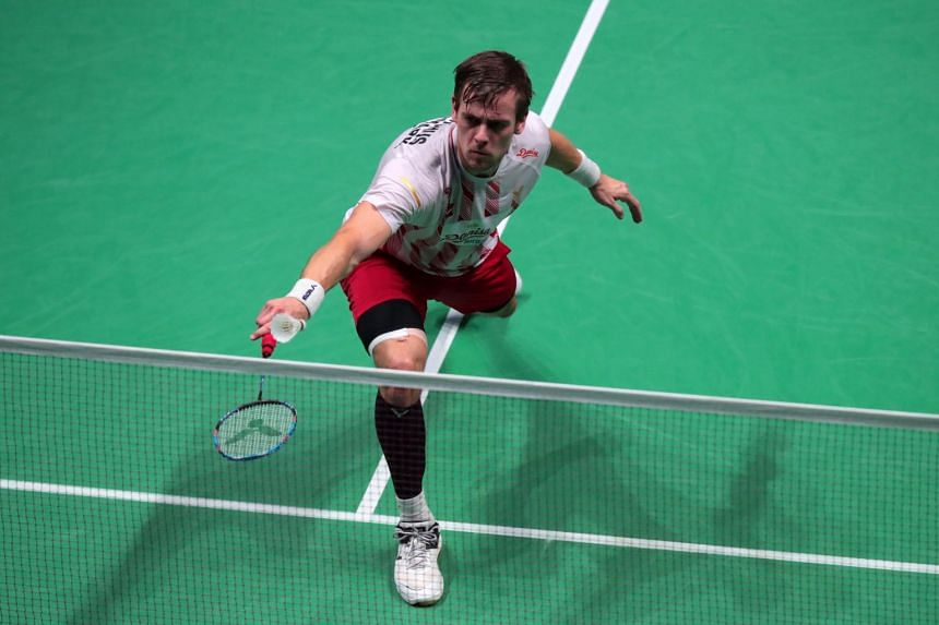A photo taken on Oct 24, 2019 of Hans-Kristian Solberg Vittinghus of Denmark in action against Kento Momota (unseen) of Japan during their Men's second round match at the Yonex Badminton French Open tournament in Paris, France.