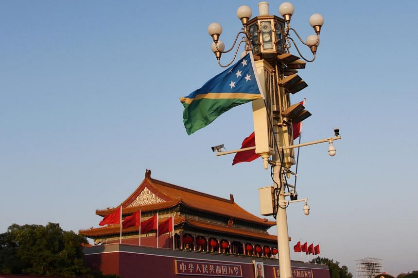 A photo taken on Oct 7, 2019 of the national flags of Solomon Islands and China in Beijing, China. The leased island, Tulagi, hosted American bases in WWII and is where Solomons' former capital city was previously located.